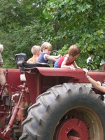 kids flying a tractor