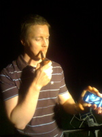 Fennell, with iPhone and pipe, at the party