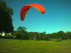 yes, this is a parasail. In a park in Arlington, Mass.