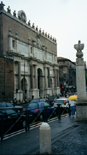 The arch at the entrance to the Piazza was originally one of the main entrance gates to Rome.